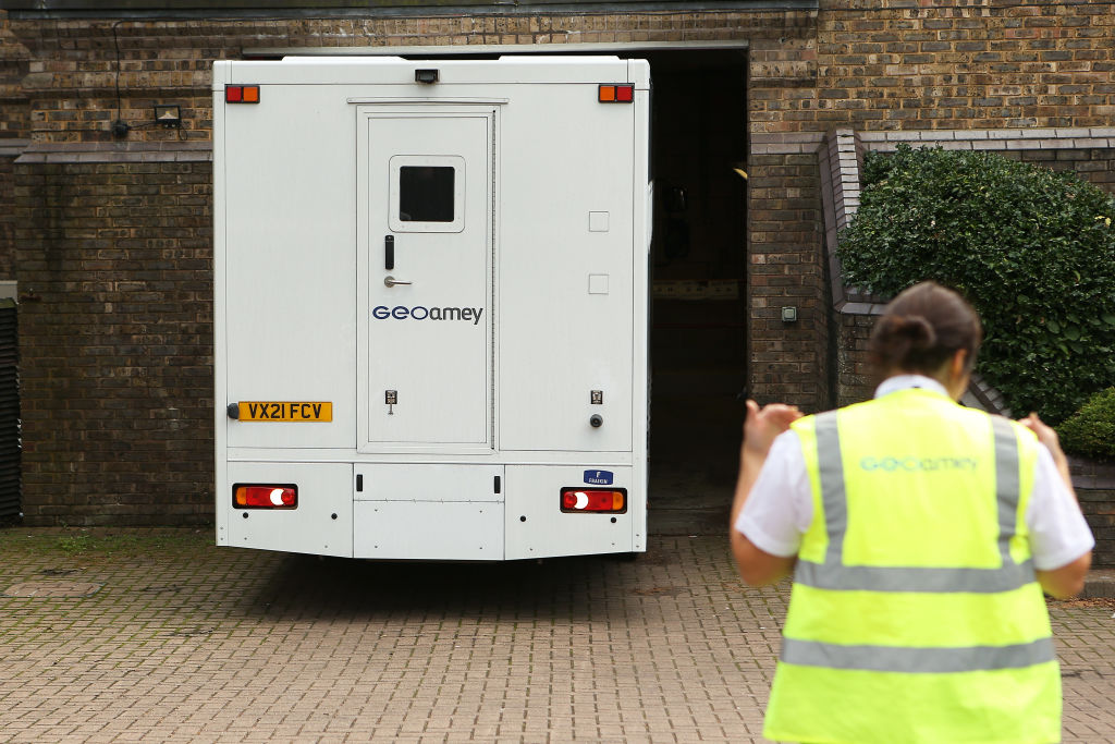 Prison officers guide a van containing Benjamin Mendy outside Chester magistrate's court.