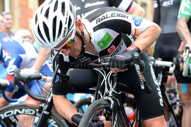 Graham Briggs checks tyres, British circuit race national championships 2013