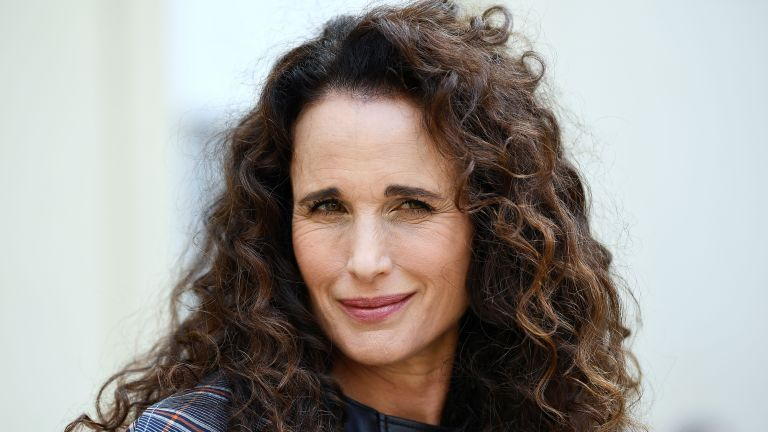 US actress and model Andie MacDowell poses as she arrives for the Cedric Charlier Spring-Summer 2019 Ready-to-Wear collection fashion show in Paris, on September 28, 2018