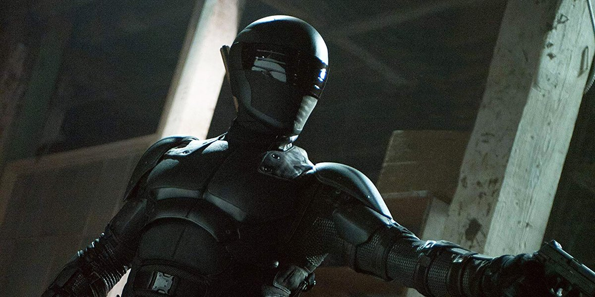 Snake Eyes aiming his weapon