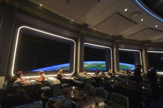 The new Space 220 restaurant, part of the Mission: SPACE pavilion at Walt Disney World's Epcot Center in Florida, provides guests the chance to dine on a space station in Earth orbit.