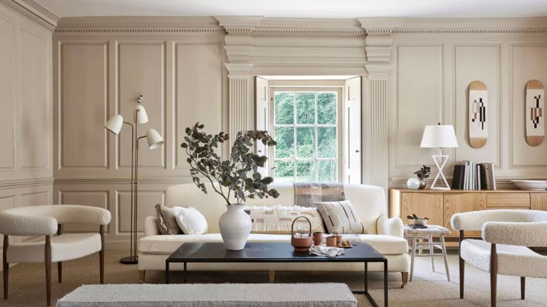 A bright living room decorated in neutral colors