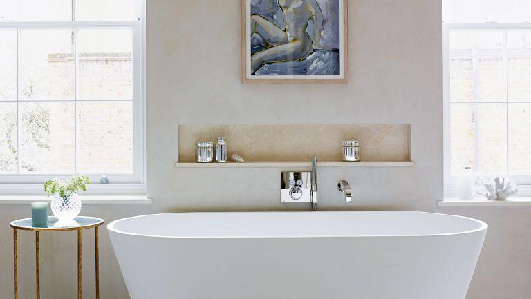 Cream bathroom with rolltop bath and bathroom shelf in niche