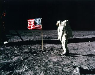 Buzz Aldrin saluting the U.S. flag on the surface of the moon