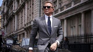 Daniel Craig wearing sunglasses as James Bond in No Time to Die as James Bond