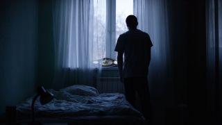 A person alone in a room.