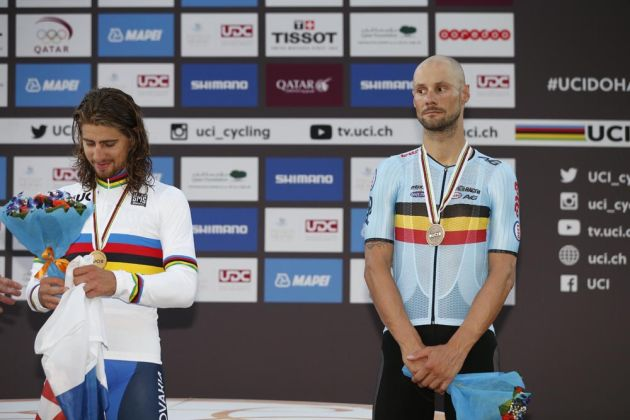 Tom Boonen (right) look at Peter Sagan on the podium of the 2016 Road World Championships