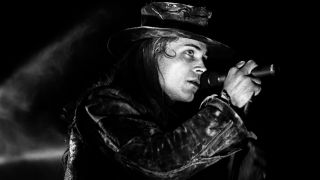Fields of the Nephilim perform on stage, United Kingdom, 1990