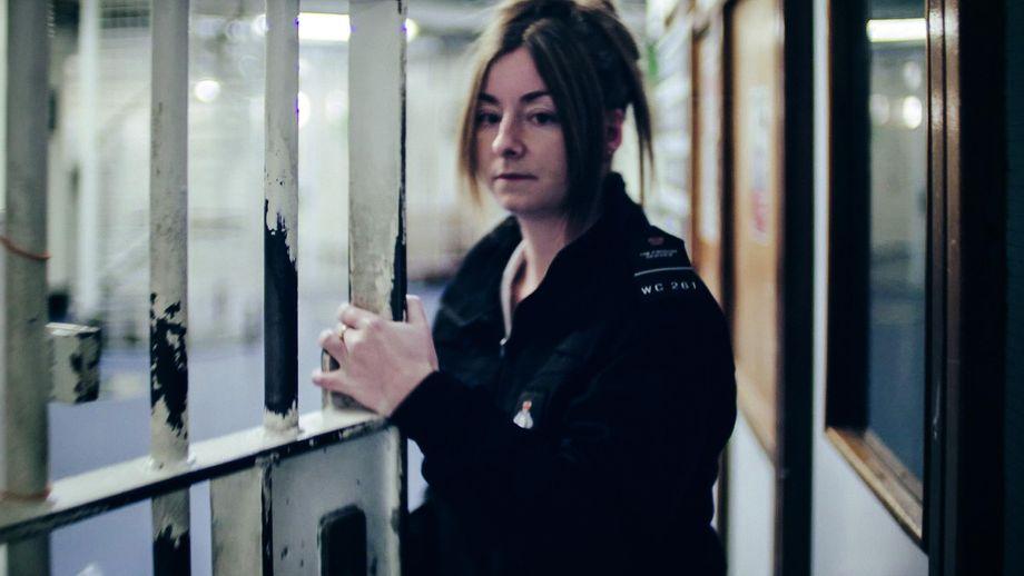 A warder locks up