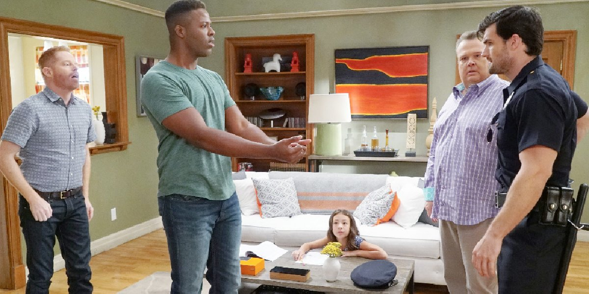 Winston Duke as Dwight in Cam and Mitch's living room in Modern Family.