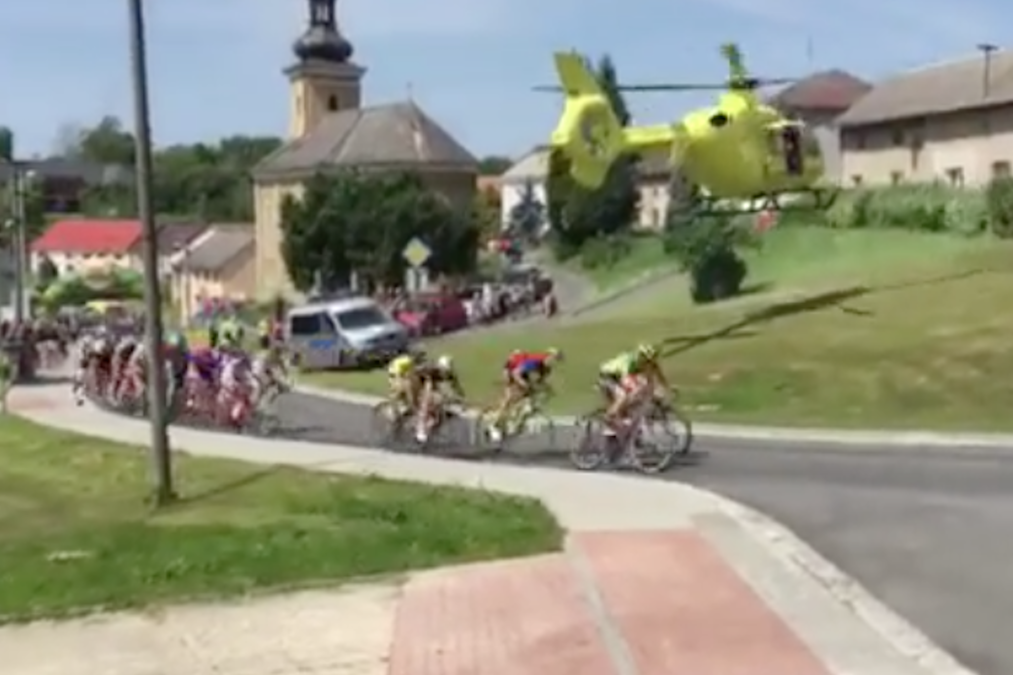 Watch: Helicopter blows peloton off the road as it takes off