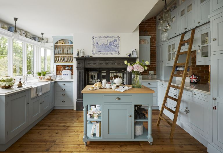 blue-kitchen-with-traditional-aga-ladder-flowers-wood-floors