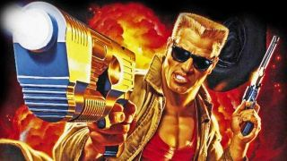Duke Nukem with arm outstretched, pistol in hand, aiming at the screen