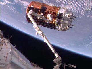 The Japanese Aerospace Exploration Agency HTV-6 cargo ship arrived at the International Space Station on Dec. 13, 2016 and is seen here at the end of the station's robotic arm after its successful capture.