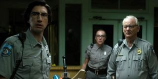 The Dead Don't Die Adam Driver, Chloe Sevigny, and Bill Murray staring at a zombie in their police d