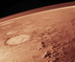 The thin Mars atmosphere today composed mainly of carbon dioxide as depicted in this artist's illustration.