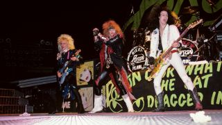 Poison, CC DeVille, Bret Michaels and Bobby Dall performing on stage
