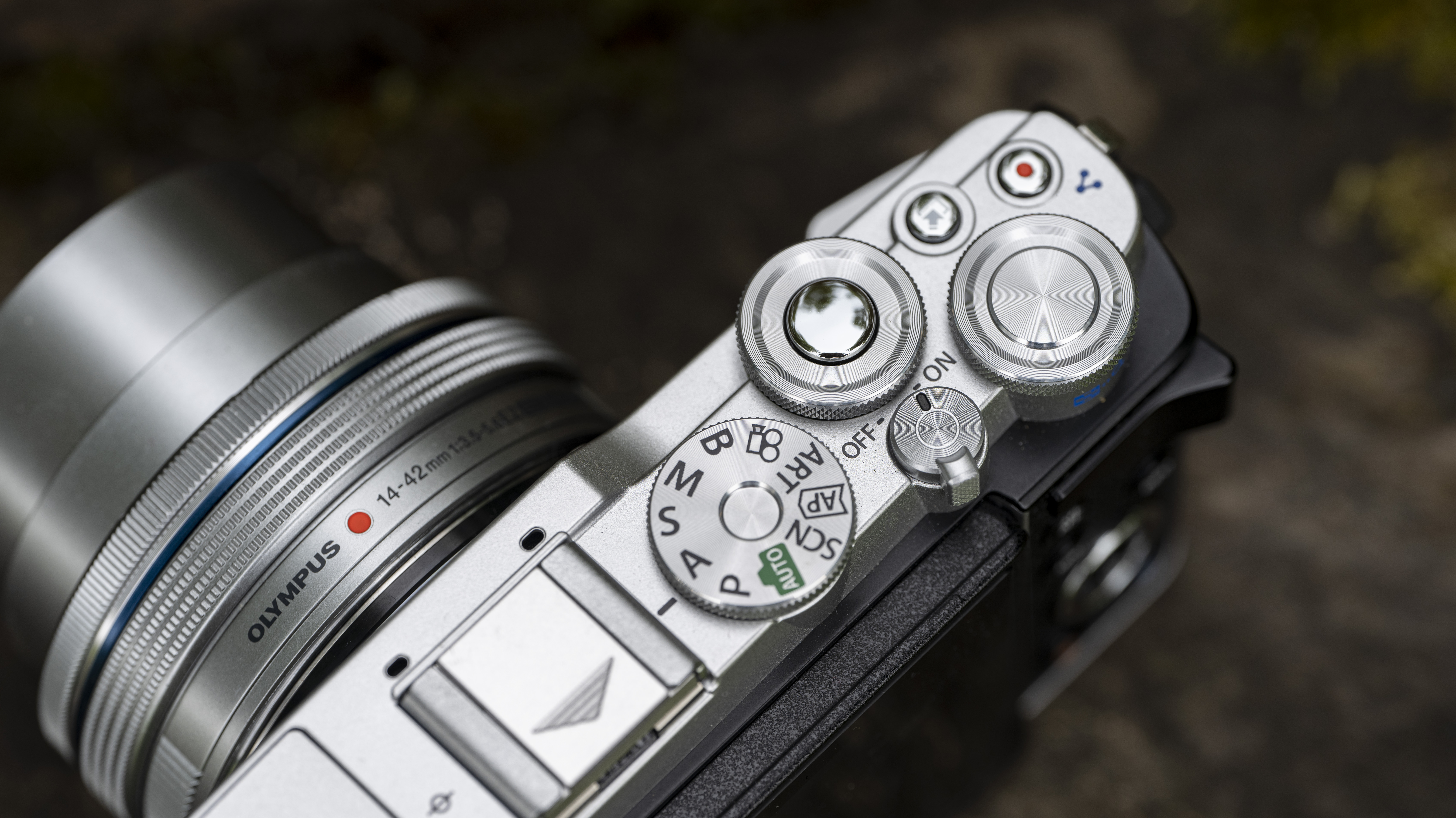 The top plate and dials of the Olympus E-P7