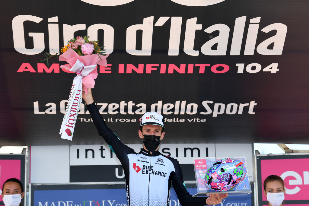 ALPE DI MERA VALSESIA ITALY MAY 28 Simon Yates of United Kingdom and Team BikeExchange stage winner celebrates at podium during the 104th Giro dItalia 2021 Stage 19 a 166km stage from Abbiategrasso to Alpe di Mera Valsesia 1531m Stage modified due to the tragic events on May the 23rd 2021 that involved the Mottarone Cableway Kask Utopia Giro Helmet designed by MotoGP artist Aldo Drudi to stage winners UCIworldtour girodiitalia Giro on May 28 2021 in Alpe di Mera Valsesia Italy Photo by Stuart FranklinGetty Images
