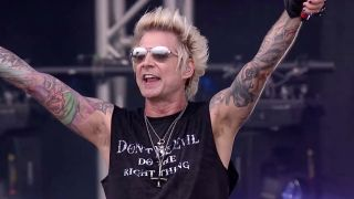 Sixx AM's James Michael sporting a 'Don't Be Evil' t-shirt onstage at Download