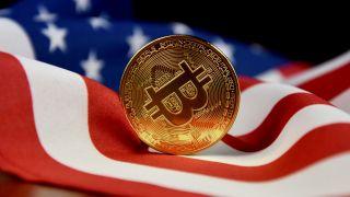Bitcoin sitting on American flag