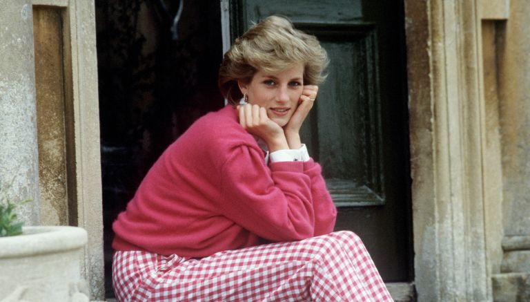 Diana, Princess of Wales (1961 - 1997) sitting on a step at her home, Highgrove House, in Doughton, Gloucestershire, 18th July 1986.