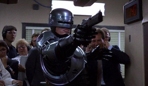Peter Weller as RoboCop in RoboCop aiming a gun