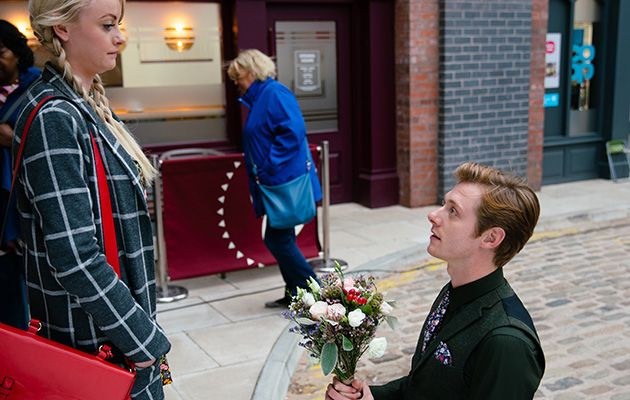 As Sinead Tinker [KATIE MCGLYNN] steps off the tram she's floored to see the beautifully decorated garden. Daniel Osbourne [ROB MALLARD] drops to one knee and asks her to marry him.