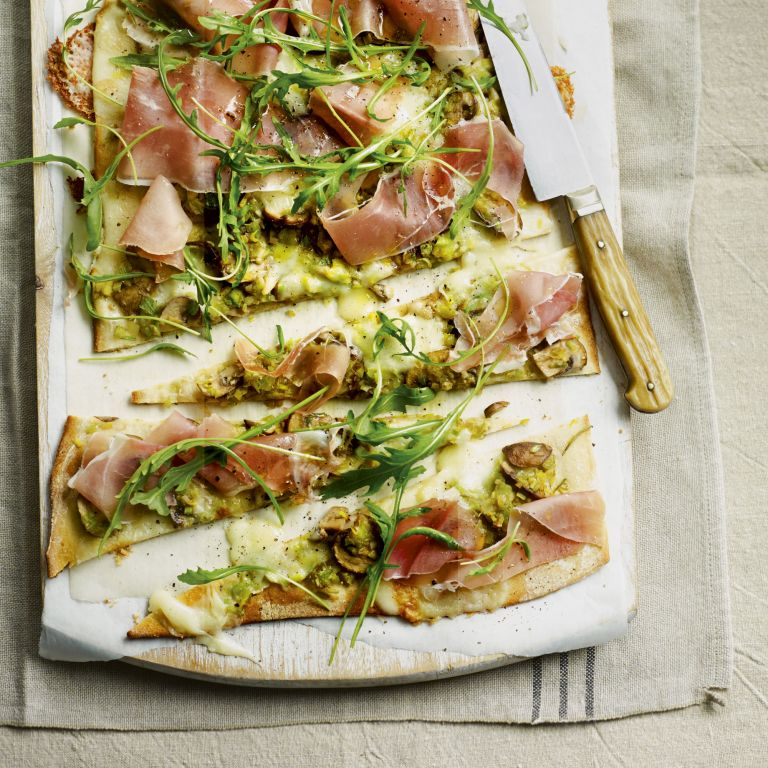 leek mushroom and taleggio pizza with sliced prosciutto