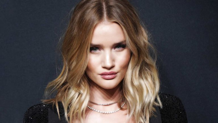 Rosie Huntington-Whiteley pictured with thick glossy wavy hair
