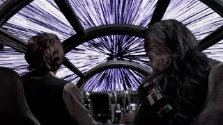 Han and Chewie look out of the cockpit as the Millenium Falcon enters hyperspace.
