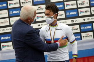 Deceuninck-QuickStep's Patrick Lefevere (left) congratulates his rider Julian Alaphilippe after winning the 2020 World Championships road race for France in Imola, Italy