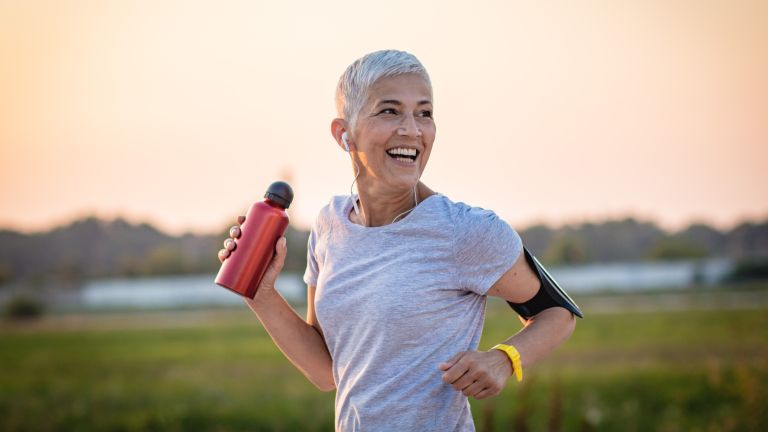 happy woman with workout motivation running outside