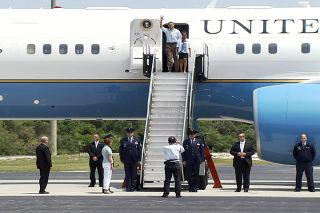 President Barack Obama and his family still visited NASA's Kennedy Space Center in Florida on Friday, April 29 despite a delayed launch of the space shuttle Endeavour. In this photo, President Obama and one of his two daughters exit Air Force One at the C