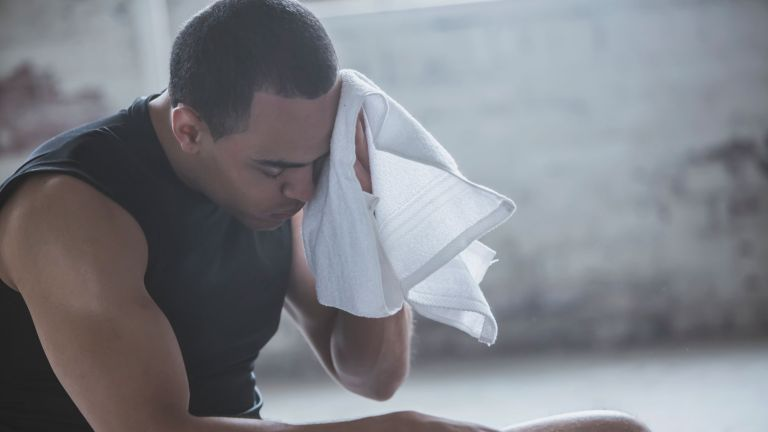 Wiping sweat after workout