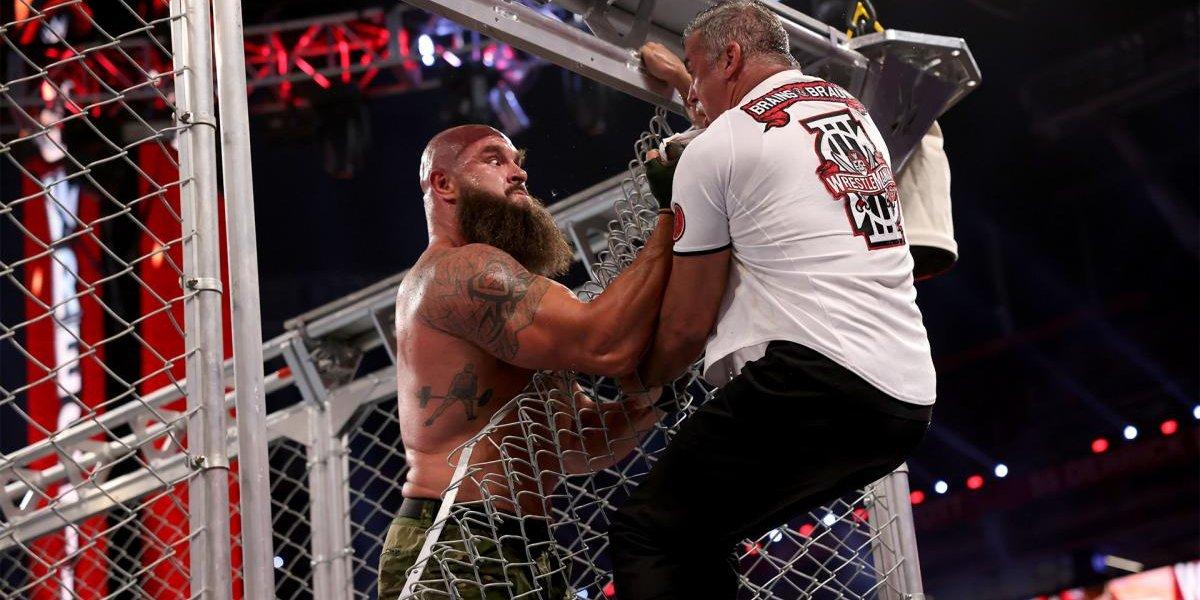 Braun Strowman pulls Shane McMahon through the cage at WrestleMania 37