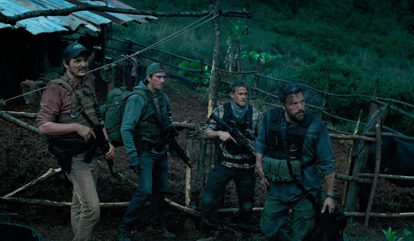 Triple Frontier Pedro Pascal Garrett Hedlund Charlie Hunnam Ben Affleck armed in the jungle, looking