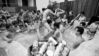 People drinking beer at a pool party