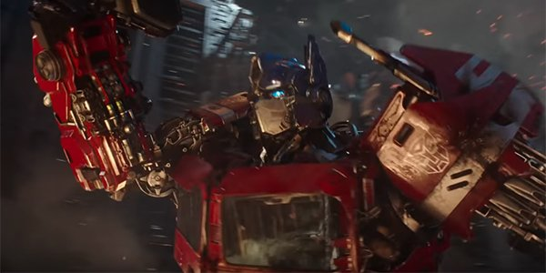 Optimus Prime charging into battle on Cybertron