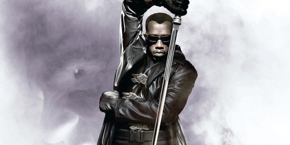 Wesley Snipes as Blade holding sword