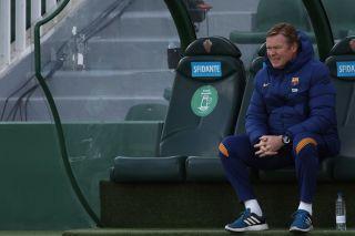 Ronald Koeman head coach of Barcelona sitting on the bench during the La Liga Santander match between Elche CF and FC Barcelona at Estadio Martinez Valero on January 24, 2021 in Elche, Spain.