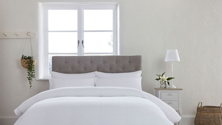 white bed with a grey headboard