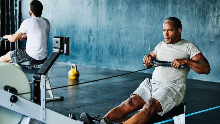 Man doing a rowing machine workout