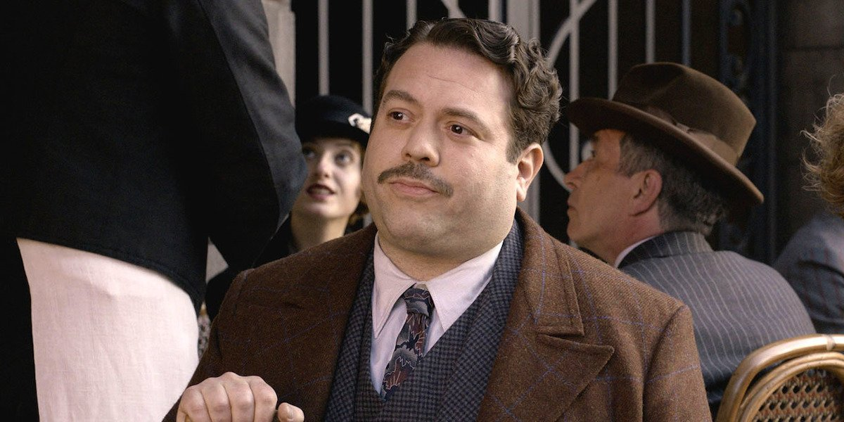 "Jacob Kowalski (Dan Fogler) sits at an outdoor table in ""Fantastic Beasts and Where To Find Them'"