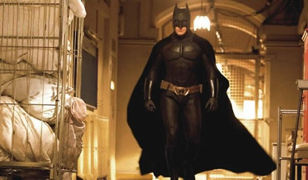 Batman Begins Christian Bale Batman strutting through Arkham