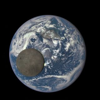 Moon Crosses Earth's Face