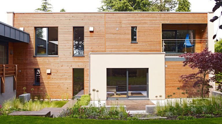 a modular home by baufritz with wood cladding and slimline windows - www.baufritz.uk