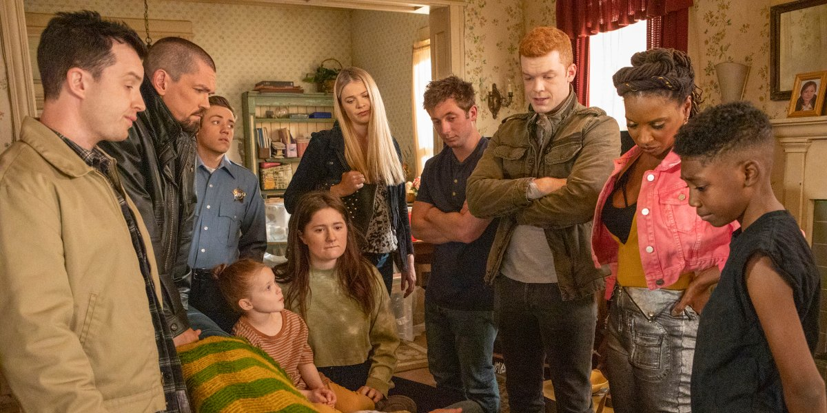 the gallagher family crowding around frank's overdose on shameless series finale
