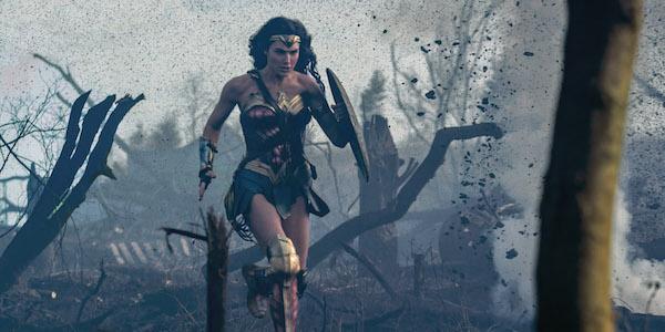 Wonder Woman charging through World War I battlefield
