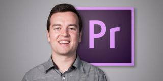 Smiling man in front of the Adobe Premier Pro logo